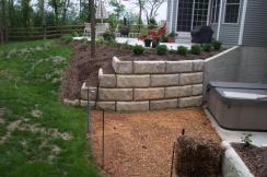 Precast concrete Redi-Rock retaining walls walkout