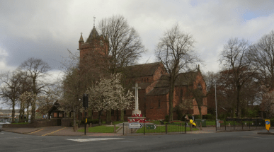 View of All Saints Church and War Memorial 2016. Trees in front.