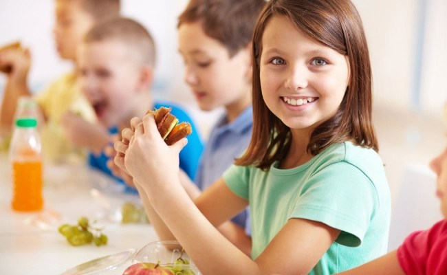 girl eating school lunch