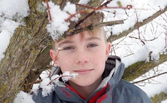 Boy enjoying snow experiments