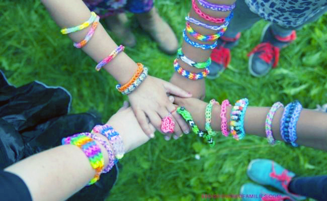 pile of hands and arms with bracelets