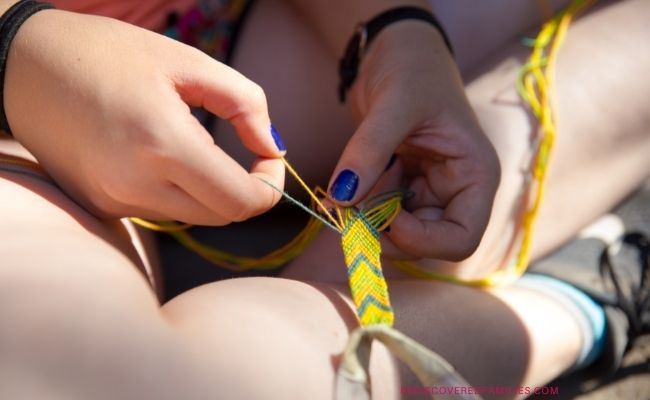 child making friendship bracelet