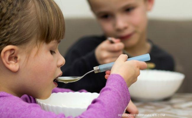 children eating soup