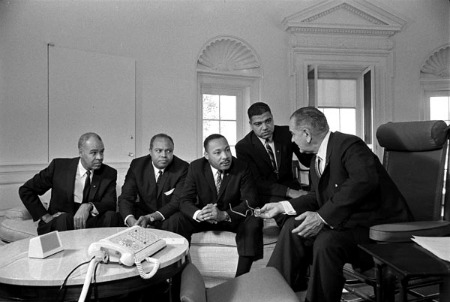 Martin Luther King, Jr. (center), with Roy Wilkins, James Farmer, and Whitney Young, met with President Lyndon Johnson in the Oval Office on January 18, 1964. (LBJ Library)