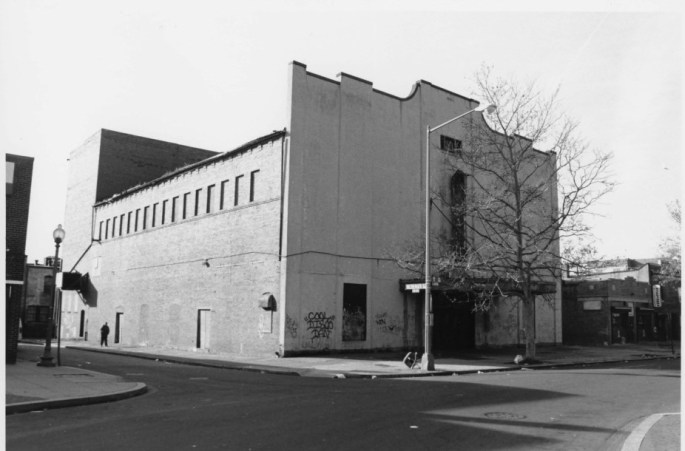 photo showing the boarded up Howard Theater