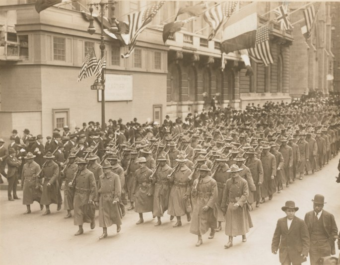 soldiers marching in columns down NY street