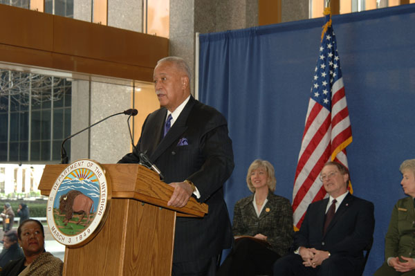 Mayor Dinkins standing at a podium speaking