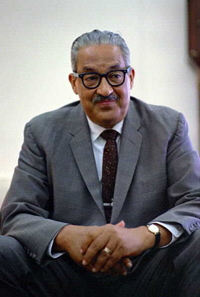 Thurgood Marshall sitting with his hands in front of him