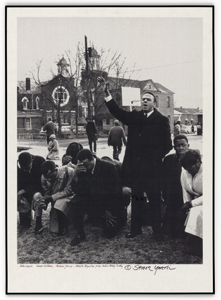 Young standing, with Lewis, Williams, Boynton kneeling in prayer