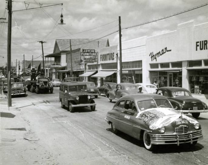 Juneteenth Celebration Parade with Packard car in foreground in Houston, Texas in 5th Ward (Lyons Avenue) or 4th Ward (West Dallas)