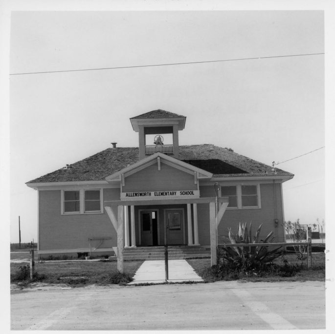 front view of 1 story school bldg w/bell on top