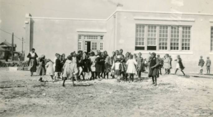 school children gathered in the school yard
