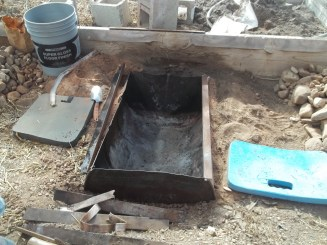 Place a half 55 gallon barrel in the hole