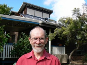 Trevor Berrill in front of his sustainable home