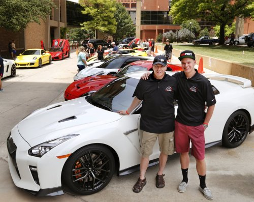 Eric Wynn, left, with his son, Chance, in front of Chance's car at Saturday's Redline4Kids event at Children's Hospital. Redline4Kids is a new nonprofit that helps connect kids in the hospital with a chance to see cool cars. Photo by Jim Beckel, The Oklahoman