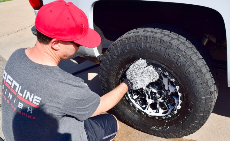 Redline Finish Wheel Wash Mitt cleaning the face of the wheel