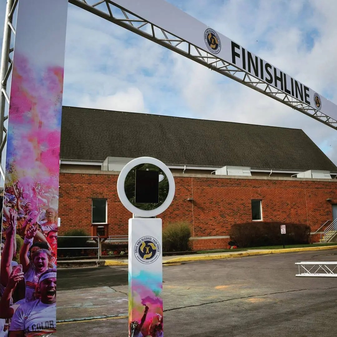 branded event arch finish line and branded photo kiosk