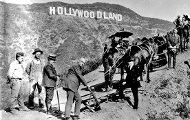 Publicity photo for the Hollywoodland groundbreaking, complete with plow, mules and surveyors. From the book, 'The Hollywood Sign' by Leo Braudy. Published by Yale University Press. Courtesy of the Bruce Torrence Collection/Hollywood Sign Trust