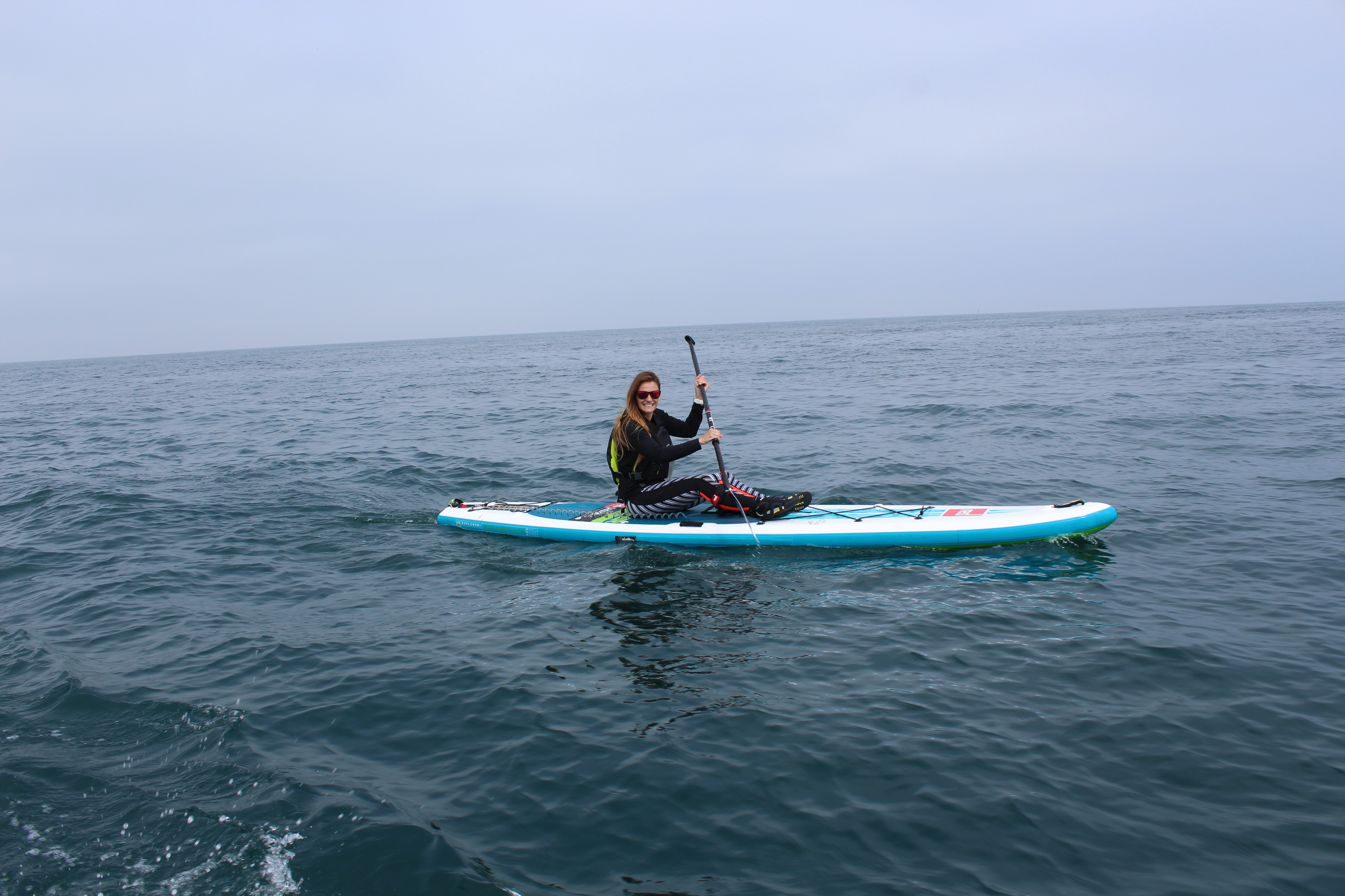 """Lizzie Carr on 13'2"""" Explorer Red Paddle Co board"""