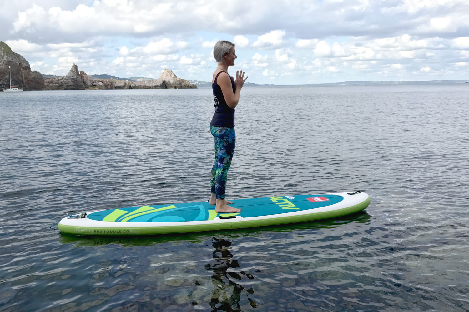 Demonstrating paddle board Yoga