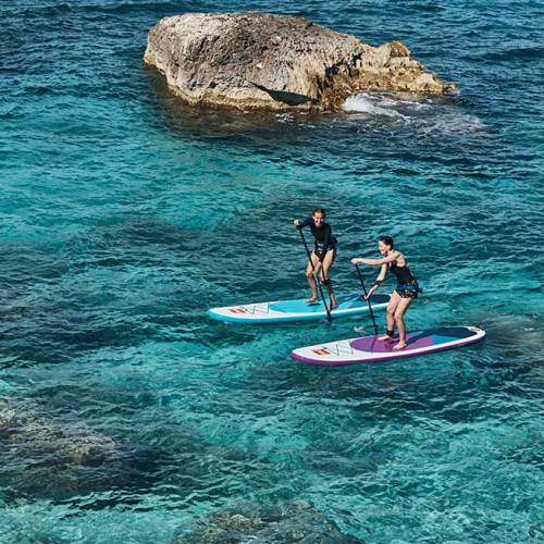 """two female friends paddle boarding on their Red Paddle Co 10'6"""" Rides"""