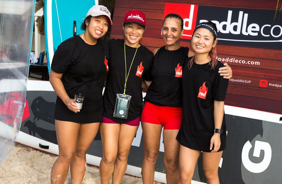four girls in SUP racing team pose for picture