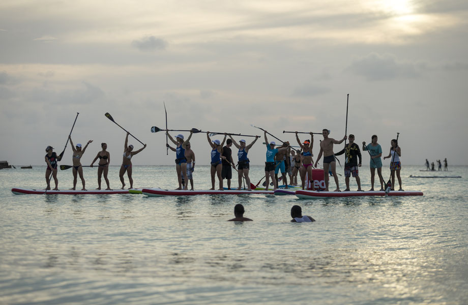 teams celebrate on dragon paddle boards