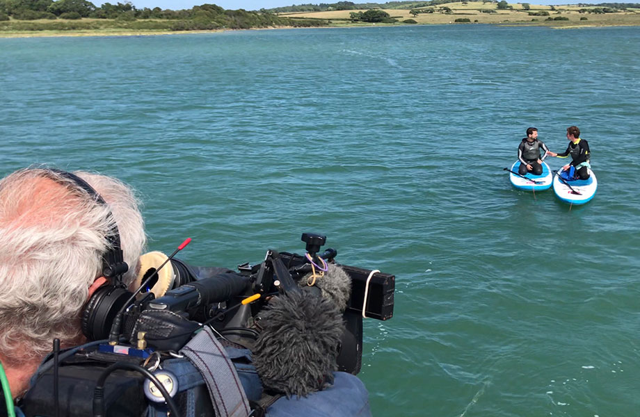 bbc filming Dr Steve on paddle boards