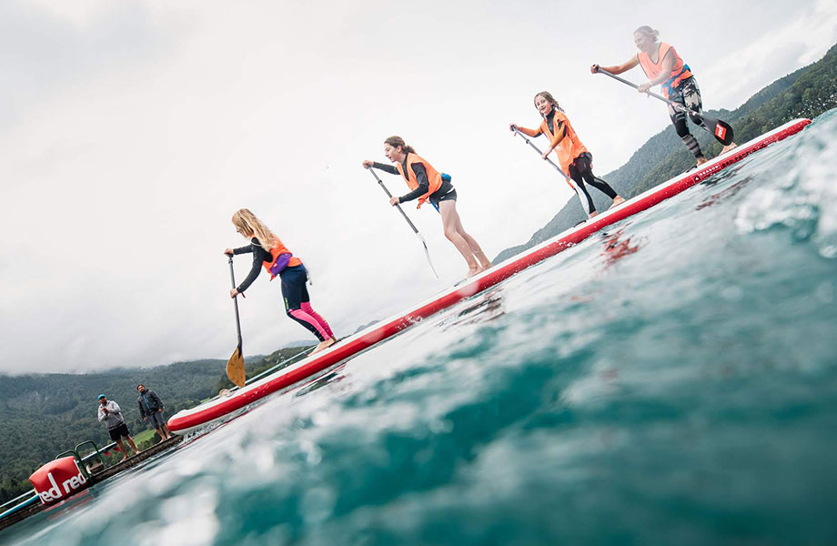 mother and three daughters paddle together on the Dragon paddle board