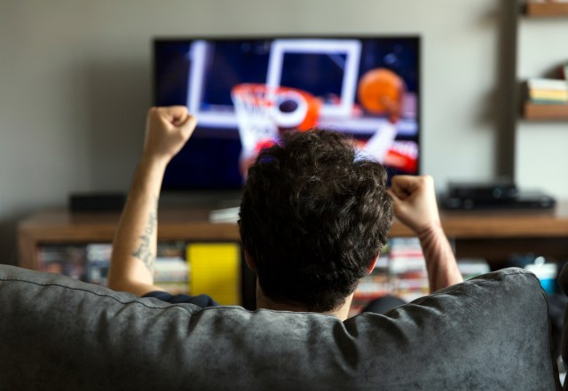 Man watching basketball on tv