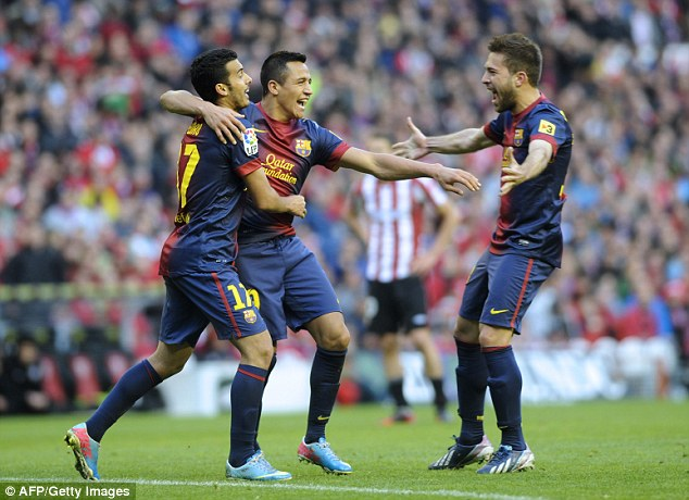 Sanchez, Pedro and Jordi Alba celebrate after the former scored against Athletic Bilbao in April 2013