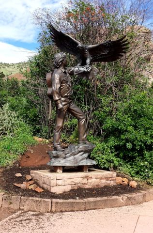 Newly installed John Denver statue in a corner of the garden. June 6, 2015.