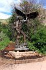 Newly installed John Denver statue in a corner of the garden. June 6, 2015.