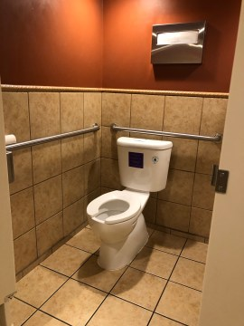 Not sure how someone in a wheelchair can reach the seat cover dispenser?