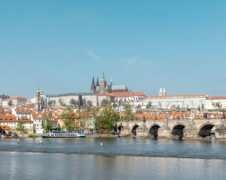 Photo of the famous Charles Bridge with theCzech Castle in the background.