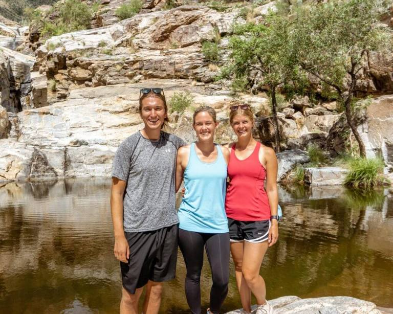 Three friends at the end of seven falls  in Tucson.