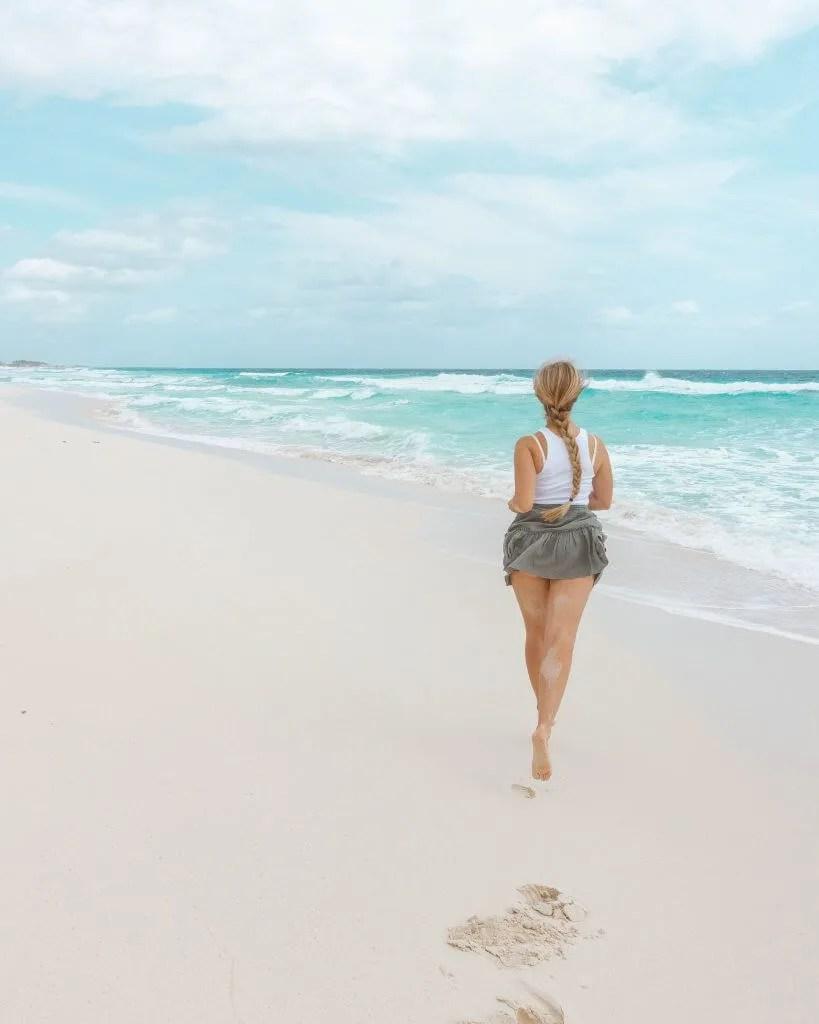 Jo running on the beach in Cozumel.