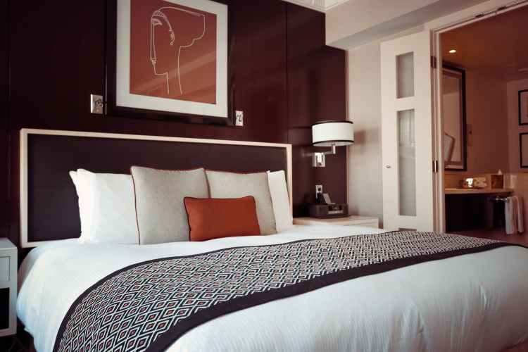 black and grey bedspread on bed and pillow