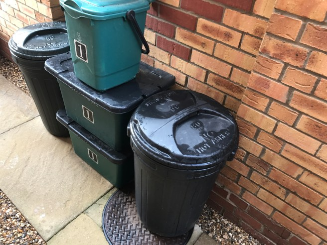 Recycling containers outside 7