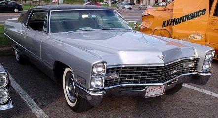 A silver 1967 Cadillac Coupe De Ville (source: http://bit.ly/1dR2qFY)