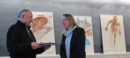 Judith Pintar (Visiting Assistant Professor of Slavic Languages and Literatures) presenting John Jurisic with a gift