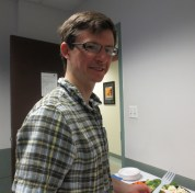 Matthew Sutton (Ph.D. Candidate in Slavic Languages and Literatures) helping himself to some refreshments.