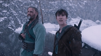 Joseph Millson (Darius) Left  and Jack Kane (Lukas) Right stand in a snow covered scene.