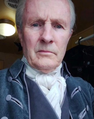 Image shows Alistair Findlay in full costume behind the scenes of Outlander