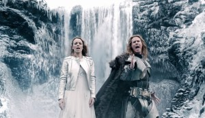 Image shows Will Ferrell right and Rachel McAdams left in front of an Icelandic waterfall.