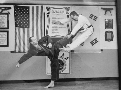 Photo shows Alex Ziwak (left) performing a Tae Kwan Do kick