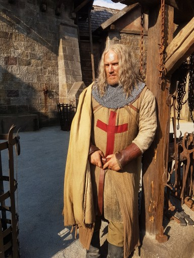 Brian Caspe dressed in full costume on the set of Knightfall