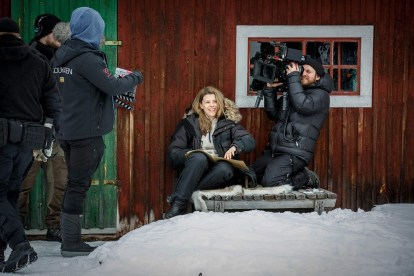 Image shows behind the scenes of Rebecka Martinsson with camera operator, clapper board, and Sascha Zacharias as Rebecka