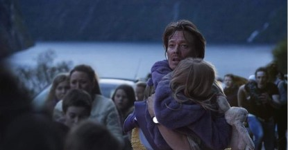 Kristoffer Joner as Kristian carrying his child to safety in The Wave