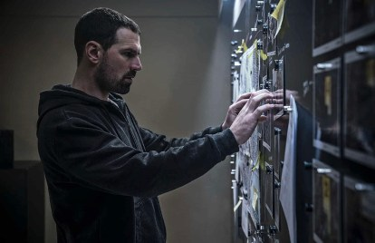 Kenneth M. Christensen as Jan Michelsen in Darkness: Those Who Kill. In this image he is attaching a photo to an incident room crime board